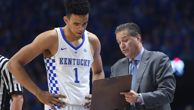 UK's Sacha Killeya-Jones receives instruction from head coach John Calipari during the University of Kentucky basketball game against Canisius at Rupp Arena in Lexington, KY on Sunday, November 13, 2016.
