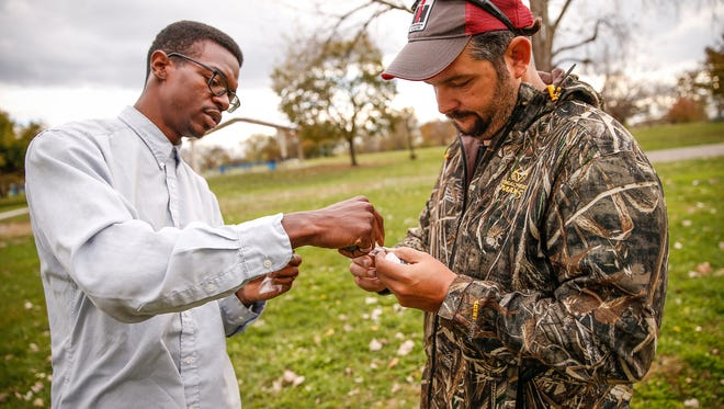 Mat Davis, left, food justice coordinator at the Flanner House, speaks with Jonathan Lawler, who owns and operates of Brandywine Creek Farms, about testing the soil near the Flanner House in preparation to develop a farm on 2 1/2 acres in the heart of the largest food desert in the city on Nov. 11, 2016.