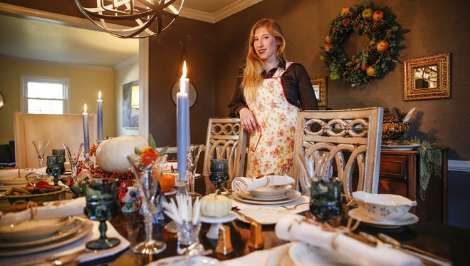 Sara Baldwin Schatz decorated her home, with help from Vintage 54, for a potluck Thanksgiving meal with friends on Wednesday, Nov. 10, 2016.
