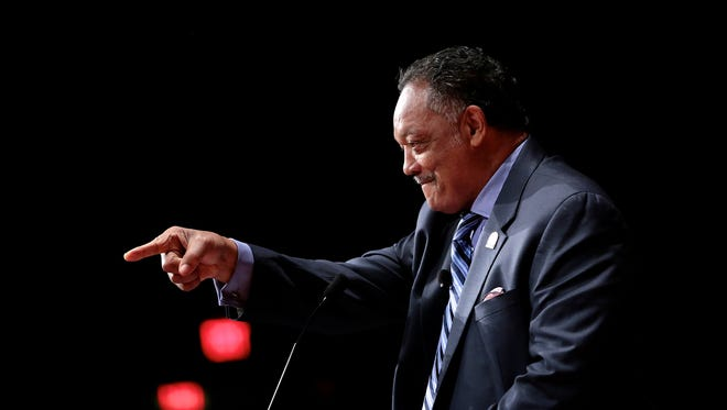 Rev. Jesse Jackson acknowledges someone in the crowd before speaking at a daylong celebration of his long career as a civil rights activist Wednesday, Nov. 16, 2016, at University of Michigan's Rackham Auditorium in Ann Arbor, Mich.