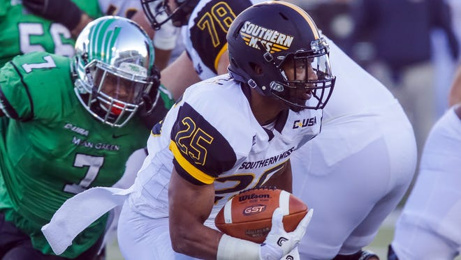 Southern Miss Golden Eagles running back Ito Smith (25) caries the ball against North Texas Mean Green  at Apogee Stadium. Mandatory Credit: Sean Pokorny-USA TODAY Sports