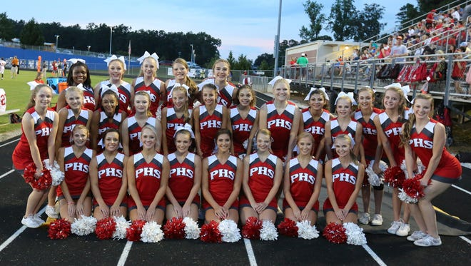 Palmetto's cheerleaders pose for a photo during an early season game. Palmetto won the Class AAA competitive cheer state championship Saturday in Columbia.