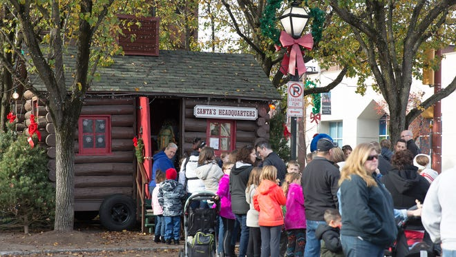 Crowds line up in front of Santa's Cabin in downtown Hanover in 2015.