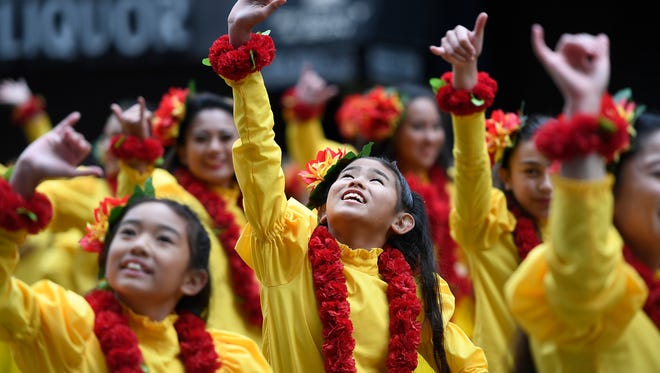 Dancers from Hawaii perform in the Macy's 90th Thanksgiving Day parade in New York City, NY on Thursday, November 24, 2016.