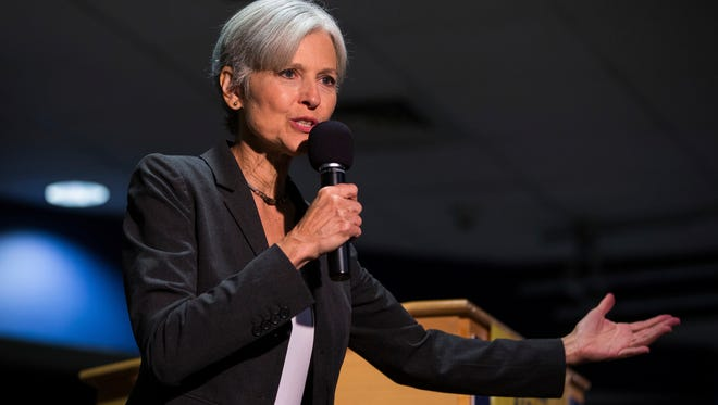 FILE - In this Wednesday, Sept. 21, 2016 file photo, Green Party presidential candidate Jill Stein delivers remarks at Wilkes University in Wilkes-Barre, Pa. Hillary Clinton's aides and supporters are urging dispirited Democrats to channel their frustrations about the election results into political causes - just not into efforts to recount ballots in three battleground states. The effort is being fueled by Stein, who's formed an organization to try to force recounts in Wisconsin, Michigan and Pennsylvania. (Christopher Dolan/The Citizens' Voice via AP, File)