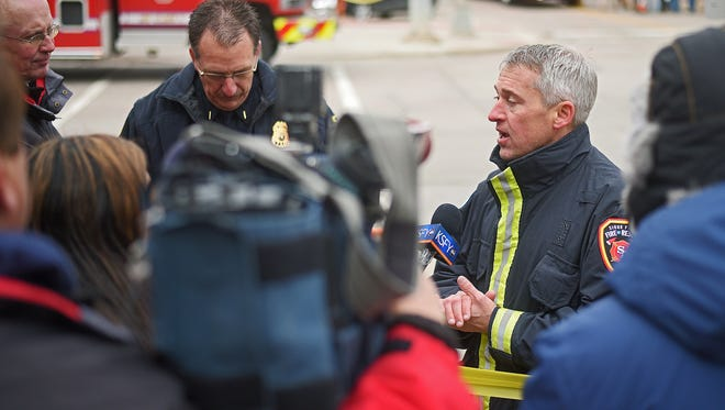 Regan Smith, Sioux Falls emergency manager, speaks to the media on the scene after the Copper Lounge building collapse Friday, Dec. 2, 2016, in downtown Sioux Falls.