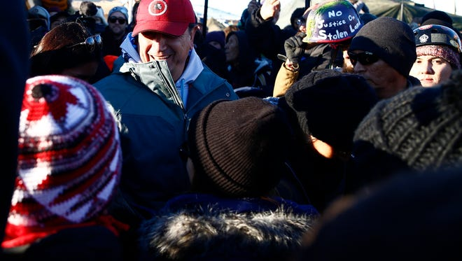 Standing Rock Sioux Tribal Council Chairman, Dave Archambault II greets demonstrators as they celebrate after the Army Corps of Engineers denied Dakota Access an easement to cross the Missouri River on Sunday, Dec. 4, 2016 near Cannon Ball.