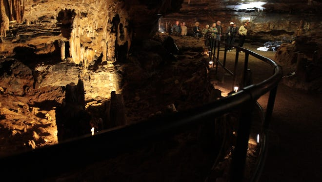 A tour group pauses inside the Cherokee Caverns on Saturday, Feb. 9, 2013. Cherokee Caverns will host its Christmas in the Cave events starting Friday, Dec. 9.