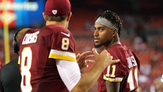 Washington wide receiver DeSean Jackson, right, talking with quarterback Kirk Cousins, has 39 receptions for 644 yards this season.