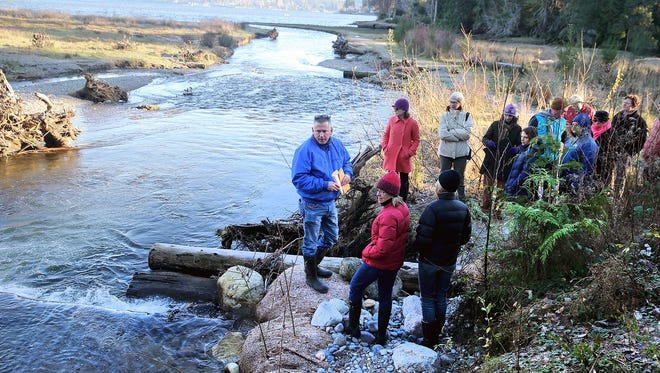 Tom Ostrom, of the Suquamish Tribal Fisheries, leads a tour of a Chico Creek restoration site with members of the Puget Sound Partnership on Dec. 7, 2016. Federal funding for such restoration projects would decline sharply under a budget proposal to be put forward by President Donald Trump.