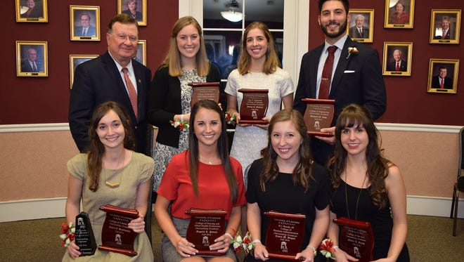 Eight UL Lafayette seniors have been recognized as Outstanding Graduates. Seated from left, are: Amélie Desormeaux, College of Liberal Arts; Angelle Patout, College of Nursing and Allied Health Professions; Casey Dugas, B.I. Moody III College of Business Administration; and Nataly Kruh Elendt, College of the Arts. Standing, from left, are: Dr. Joseph Savoie, UL Lafayette president; Amanda Sphar, College of Education; Juliane Mahoney, Ray P. Authement College of Sciences; and Benjamin Como, College of Engineering. Not pictured is Erica Didier, University College.