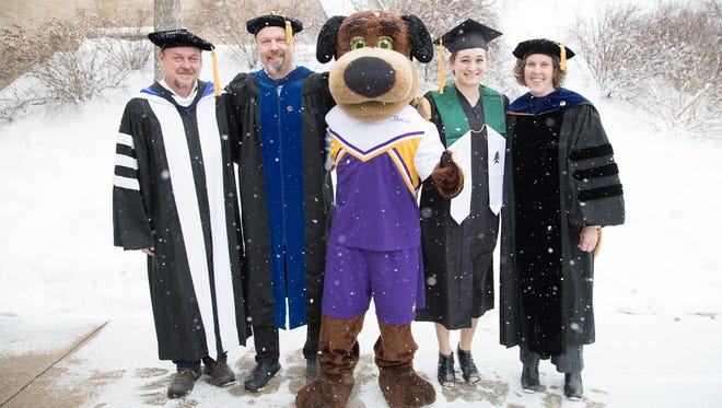 A snowstorm didn't keep students, faculty, staff and families from celebrating as UW-Stevens Point held its Winter Commencement ceremony on Dec. 17, 2016. Enjoying the weather on graduation day are English Professor Dave Arnold, Biology Associate Professor Justin Sipiorski, Stevie Pointer, biology and water resources graduate Kayla Fuller of Baraboo and Professor Karin Bodensteiner.
