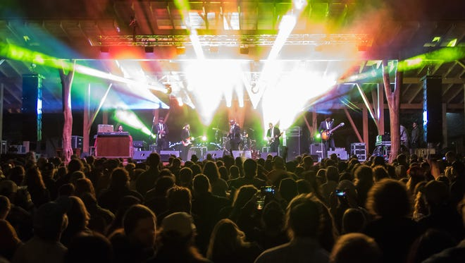 Pisgah Brewing's outdoor stage lights up for its 11th Anniversary Party.