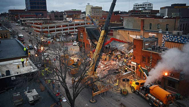 Emergency personnel on scene after the Copper Lounge building, which was being renovated, collapsed Friday, Dec. 2, 2016, in downtown Sioux Falls. Friday's building collapse injured Emily Fodness, who was rescued by emergency personnel after about three hours of being trapped, and killed Ethan McMahon. McMahon's body was recovered over seven hours after the collapse. Three dogs, all of which were rescued, were also trapped in the collapse. One of the dogs was rescued more than 48 hours after the collapse, the other two were rescued in the first 24 hours.
