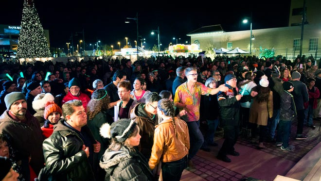 The Plaza  de Las Cruces was filled with people from Las Cruces, El Paso and other surrounding cities, with food trucks, photo booths and live music, Cruces rang in the new year with a green chile, to the sound of Auld Lang Syne, Saturday December 31, 2016.