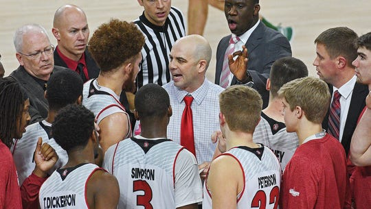 USD head men's basketball coach Craig Smith talks with