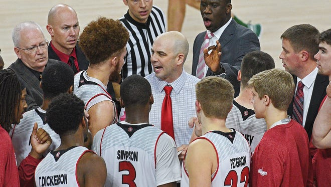 USD head men's basketball coach Craig Smith talks with his team during a timeout during a game against NDSU Wednesday, Jan. 11, 2017, at the USD Sanford Coyote Sports Center in Vermillion, S.D. USD fell 70-69 to NDSU.