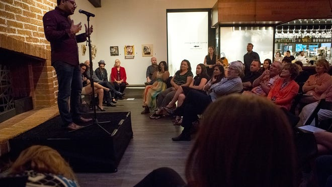 Moazam Khan speaks at the Arizona Storytellers Design and Architecture show at Changing Hands First Draft Book Bar on Wednesday, April 6, 2016, in Phoenix, Ariz.