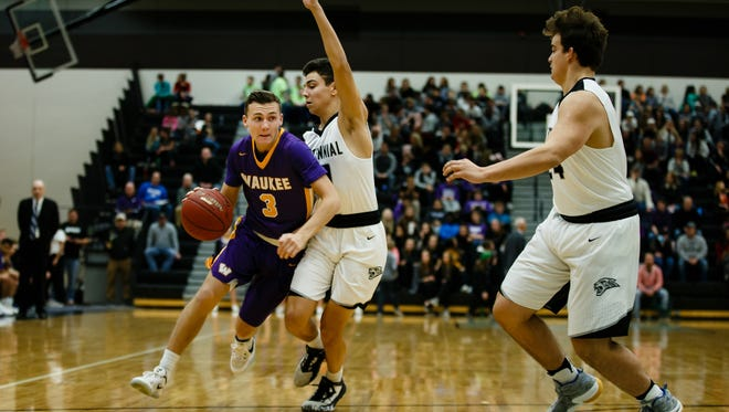 Waukee's Jacob Rau works around Ankeny Centennial's Hunter Strait during their game at Ankeny Centennial on Friday, Jan. 13, 2017, in Ankeny.