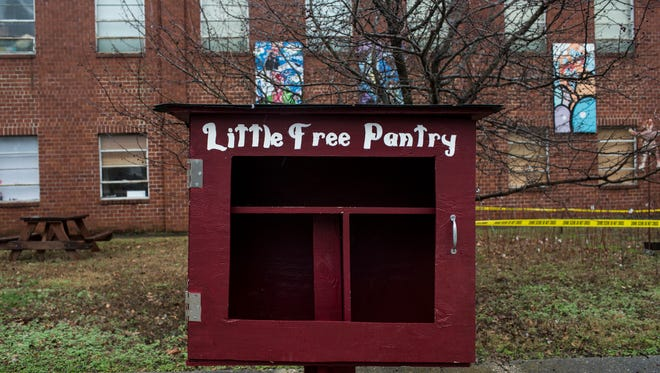 """January 19, 2017 - A """"Little Free Pantry"""" is seen outside of Caritas Village in Binghamton. """"It doesn't really alleviate the problem of hunger, it just makes it more visible,"""" Onie Johns, founder of Caritas Village, said about the """"Little Pantry."""" The pantry is filled with food each Monday and is free for people to come and take what they need. Johns said the pantry is usually empty on Tuesday but is also designed for neighbors to be able to add food to them as well."""