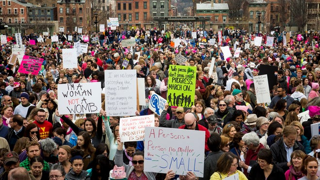 Thousands gather at Washington Park in Cincinnati, before the Sister March to the Women's March on Washington Saturday, January 21, 2017.