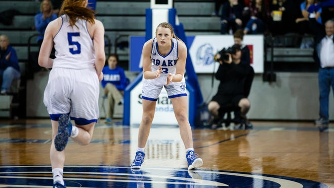 Drake's Lizzy Wendell cheers on her teammate Becca Hittner during their basketball game against Indiana State on Sunday, Jan. 22, 2017, in Des Moines.