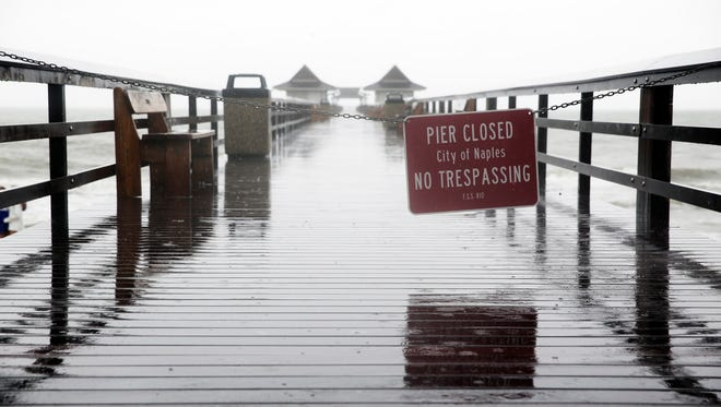 The Naples Municipal Beach and Fishing Pier closed due to severe weather on Tuesday, Aug. 30, 2016.