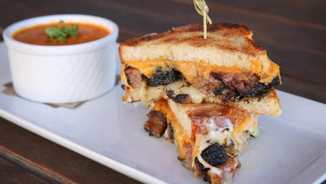 Chopped Brisket Grilled Cheese with smoky Cheddar cheese, pepper Jack cheese and a grilled tomato.