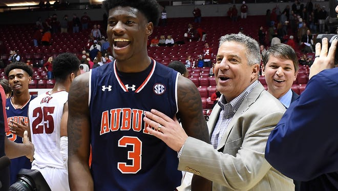 Auburn forward Danjel Purifoy (3) and Tigers head coach Bruce Pearl after 82-77 win at Coleman Coliseum on Saturday, Feb. 4, 2017, in Tuscaloosa, Ala.