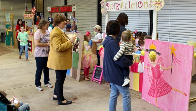 Entrepreneurs with various lemonade stands try to draw in customers to their stand during Contest Day at the Wichita Falls Farmers Market Saturday morning. Lemonade Day will be April 30 and feature stands run and designed by young entrepreneurs from around the city.