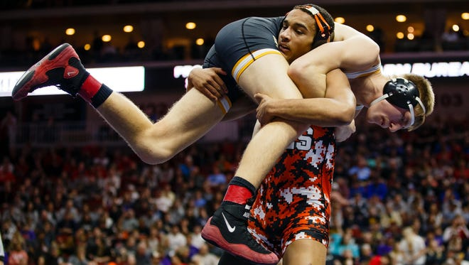 Southeast PolkÕs Gavin Babcock wrestles Marcus Coleman of Ames during their class 3A 170 pound championship match at the Iowa high school state wrestling tournament on Saturday, Feb. 18, 2017 in Des Moines.