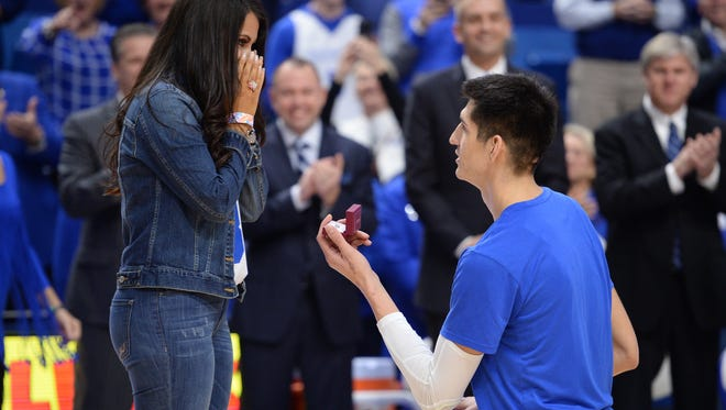 UK senior Derek Willis proposes to his girlfriend before to the University of Kentucky basketball game against Vanderbilt University at Rupp Arena in Lexington, KY on Tuesday, February 28, 2017.