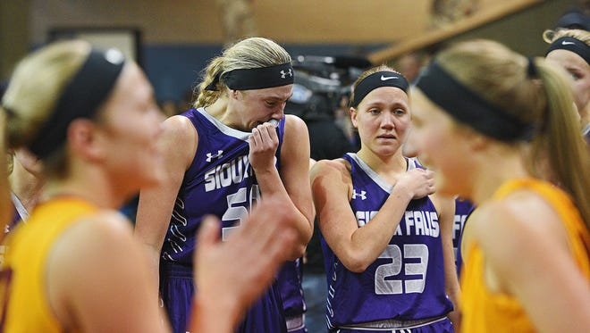 USF's Sam Knecht (50) and Jacey Huinker (23) after their 55-52 loss to Northern State in the NSIC Women's Basketball Championship game Tuesday, Feb. 28, 2017, at the Sanford Pentagon in Sioux Falls.