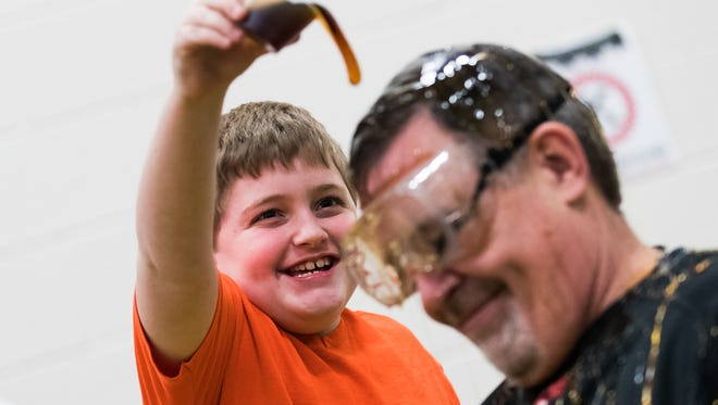 Clearview Elementary School principal Jay Czap is doused in syrup and feathers by second and fourth grade students at Clearview Elementary School on Friday, March 3, 2017 in Hanover after the school raised $1,038 in two weeks for Caring Hearts, a school program that helps families in need.
