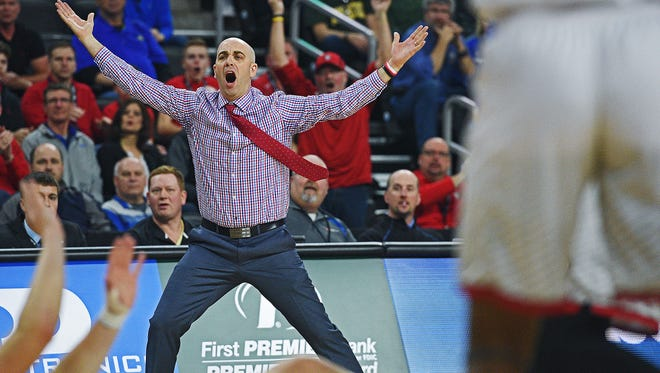 USD head coach Craig Smith reacts to an official's call during a Summit League Tournament semifinal game against SDSU Monday, March 6, 2017, at the Denny Sanford Premier Center in Sioux Falls.