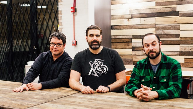"""Matt Young, from left, Arnie Niekamp and Adal Rifai are the improvisers behind the comedy-fantasy podcast """"Hello From the Magic Tavern."""" Photo by Danielle A. Scruggs"""