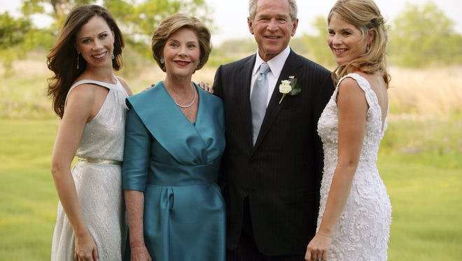President George W. Bush and first lady Laura Bush pose with daughters Jenna, right, and Barbara, left, before Jenna's marriage to Henry Hager in Crawford, Texas in 2008.