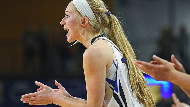 St. Thomas More's Dru Gylten (10) cheers on her teammates from the bench during a 2017 SDHSAA Class A State Girls Basketball Tournament quarterfinal game against Madison Thursday, March 9, 2017, at Frost Arena on the South Dakota State University campus in Brookings, S.D. St. Thomas More beat Madison 57-32.
