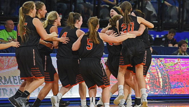 Lennox players celebrate their team's 57-50 win over Vermillion in a 2017 SDHSAA Class A State Girls Basketball Tournament semifinal game Friday, March 10, 2017, at Frost Arena on the South Dakota State University campus in Brookings, S.D. Lennox will face St. Thomas More in Saturday's final.