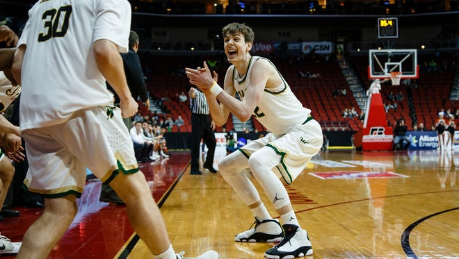 Iowa City West's Patrick McCaffery (22) cheers by the bench as the final seconds tick away during their 4A state basketball championship game on Saturday, March 11, 2017, in Des Moines. Iowa City West would go on to win 64-50