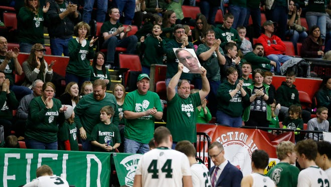 The Newfield Trojans defeated the Harrisville Pirates 65-62 in the state semifinals Friday at the Floyd L. Maines Veterans Memorial Arena in Binghamton.