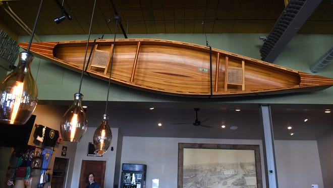 The River's Edge Brewing Company's canoe, with a $2 bill inside, likely will inspire participants in the brewery's writing contest..