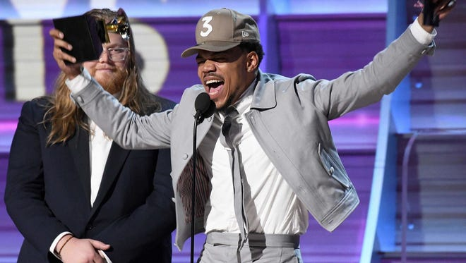 Lollapalooza announced Wednesday, March 22, 2017, that Chance the Rapper will headline the music event in Chicago in August 2017.  Here, he accepts a Grammy on Feb. 12, 2017.