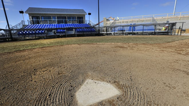 Construction crews work on an addition at Herr-Baker Field on the Marian University campus. The addition is for the new Northwoods League baseball team, The Dock Spiders, which will begin playing on the field this spring.