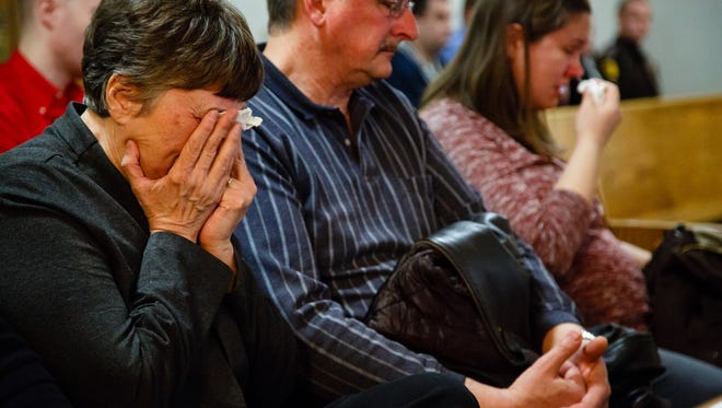 Mary Koch, the mother of Alexander Koch, wipes tears from her eyes during the sentencing hearing for William J. Phipps on Thursday, March 23, 2017, in Des Moines.