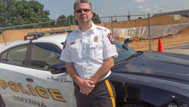 The Smyrna Town Council voted to hire an investigator to look into allegations of wrongdoing in the Smyrna Police Department and also into a no-confidence vote in Chief Norman Wood.