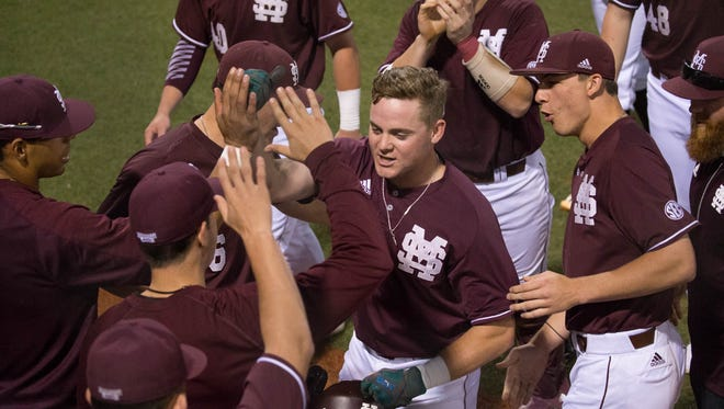 Mississippi State senior Cody Brown (26) hit a two-run home run in a win over Ole Miss Friday.