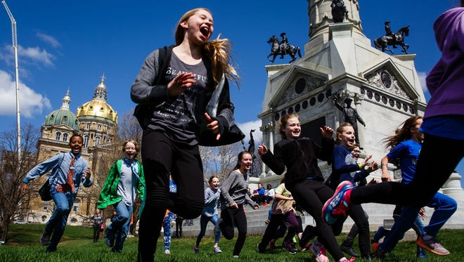 Fifth-grade students from Clear Creek Amana play during lunch after attending a school choice rally at the state Capitol on Thursday, April 6, 2017, in Des Moines.