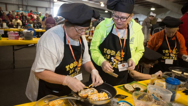 Lorna Mick of Monroe (left) won the 2016 Wisconsin Grilled Cheese Championship's Amateur Classic category.