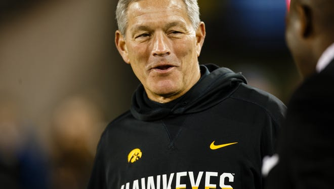 Iowa head coach Kirk Ferentz walks off the field with his players after their Spring Game on Friday, April 21, 2017, in Iowa City.